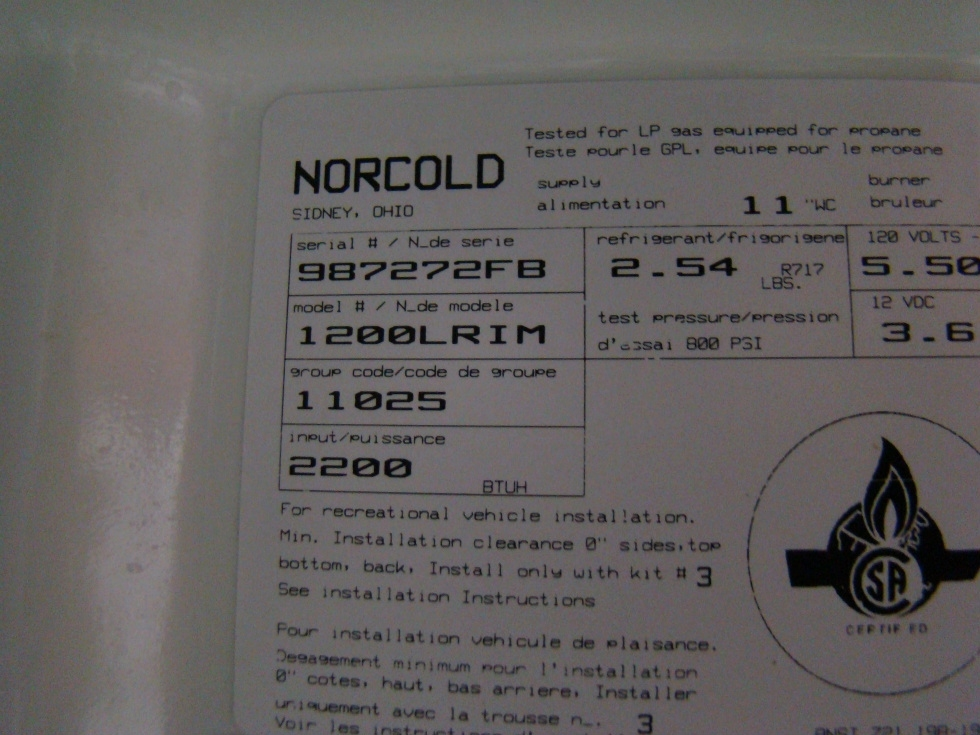 USED RV MOTORHOME REFRIGERATOR | NORCOLD 1200LRIM (WOOD PANEL)  REFRIGERATOR RV Appliances